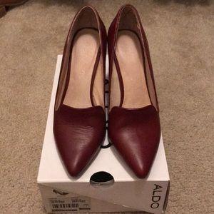 Dark red stiletto pumps